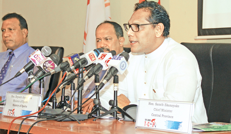 Sports Minister Dayasiri Jayasekara addressinga press briefing regarding the LSR T-Cup Cycle Race at the Olympic House, Race Course on Wednesday flanked by President of the Cycling Federation of Sri Lanka N.Karunaratne and Chairman of Lanka Sportsreizen Thilak Weerasinghe.