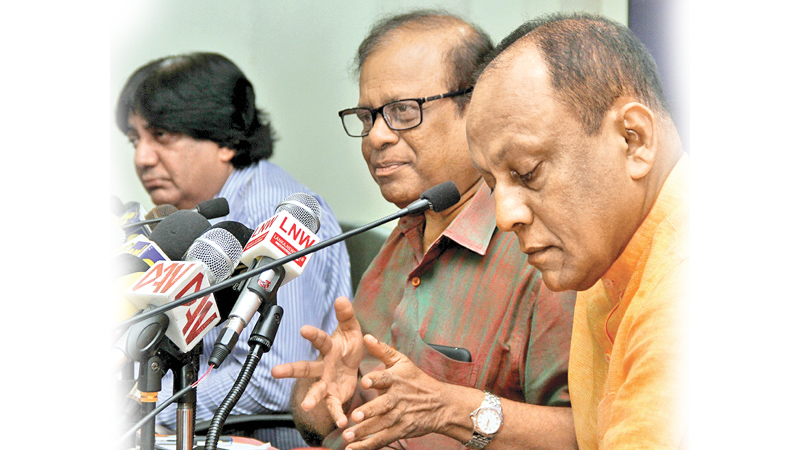Minister Susil Premajayantha, State Minister Lakshman Yapa Abeywardena and MP Dilan Perera at the media briefing at the SLFP headquarters yesterday. Picture by Nirosh Batepola