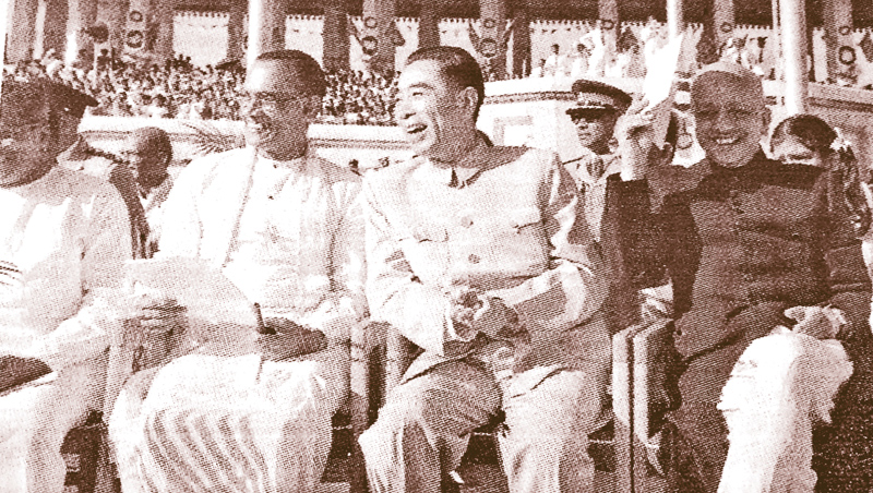 Premier Zhou Enlai with Prime Minister S.W.R.D. Bandaranaike at the Independence Day rally in Colombo in February 1957.