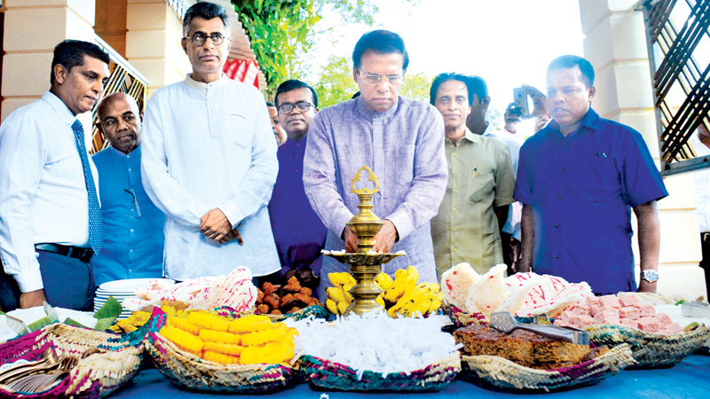 President Maithripala Sirisena lighting the oil lamp.
