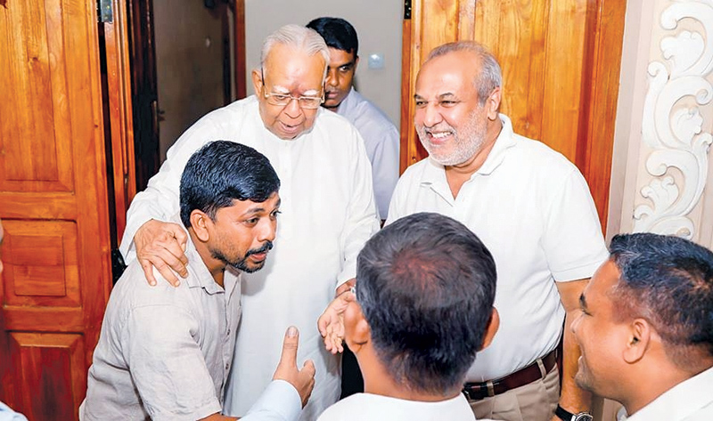 SLMC leader Minister Rauff Hakeem at the Trincomalee residence of Opposition and TNA Leader R. Sambandan on Monday. He met newly elected TNA members of local bodies too. Parliamentarian M. S. Thowfeek and party member H. M. Faiz were also present.