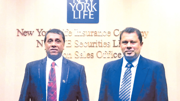 Ceylinco Life's Deputy General Managers Manjula Thenuwara and Wasantha Wijesinghe during their training at New York Life.