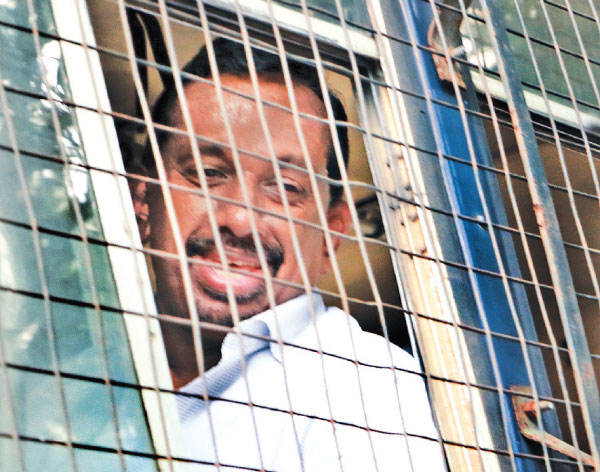 MP Mahindananda Aluthgamage who was ordered to be remanded, due to his failure to meet the bail conditions imposed by the Colombo Magistrate's Court leaving the Court premises in the prison bus. Picture by Saman Sri Wedage