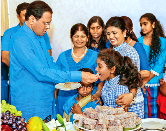 President Maithripala Sirisena celebrating the New Year with the family. Picture by Sudath Silva.