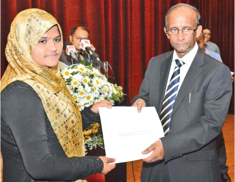 University Grants Commission of Sri Lanka Prof. Mohan De Silva presents a scholarship to a student. Picture by Sarath Peiris