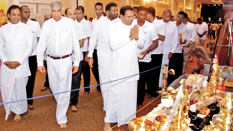President Maithripala Sirisena and Prime Minister Ranil Wickremesinghe at the public Exposition of the Sacred Relics of The Buddha brought from India and Pakistan at Temple Trees last evening. Buddhist artifacts brought from Nepal and Bhutan are also on display. Relics enshrined at Mulagandhakuti Viharaya in Sarnath in India and the relics enshrined in the Taxila Museum in Punjab were brought to Sri Lanka on Saturday. Speaker Karu Jayasuriya, Opposition Leader R.Sampanthan and other Ministers were also pre