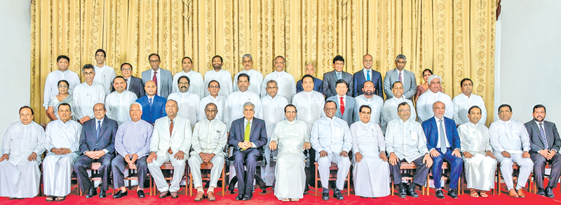 The new Cabinet Ministers sworn-in before President Maithripala Sirisena at the Presidential Secretariat yesterday.  Picture by  Sudath Silva