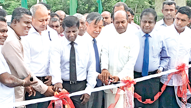 Minister Sagala Rathnayake, Japanese Ambassador Kenichi Suganuma and officials opening the rehabilitated Polwathumodara bridge.