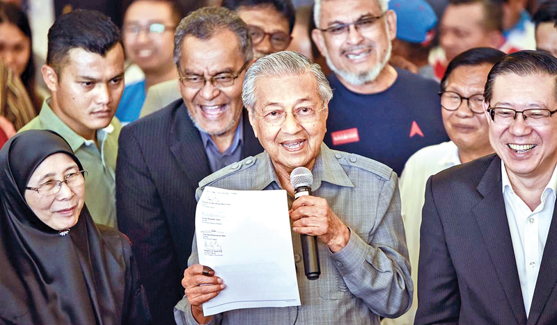 Malaysian Prime Minister Dr. Mahathir Mohamad addressing supporters. - AFP