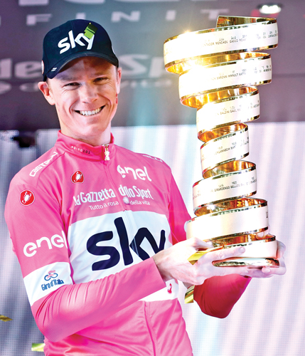 Pink jersey Britain's rider of team Sky Christopher Froome, winner, poses with the trophy on the podium after the 21st and last stage of the 101st Giro d'Italia, Tour of Italy cycling race, on May 27 in Rome. AFP