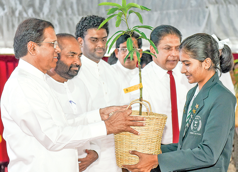 An event to celebrate World Environment Day was held under the patronage of President Maithripala Sirisena at Kegalle town yesterday. 'Beat Plastic Pollution' is Sri Lanka's national theme for World Environment Day 2018. During the event, the President distributed saplings among school students and also gave away awards for children who excelled in the World Environment Day competitions. Picture courtesy President's Media Unit