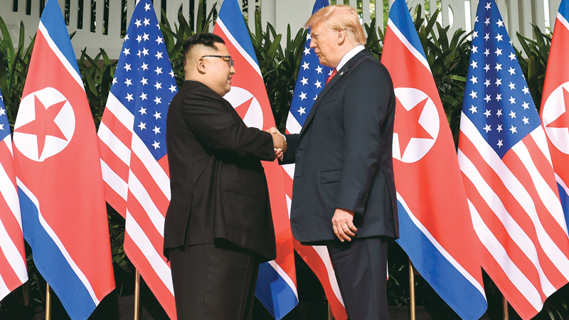 North Korea's leader Kim Jong Un shakes hands with  US President Donald Trump at the start of their historic US-North Korea  summit, at the Capella Hotel on Sentosa island in Singapore on June 12. AFP