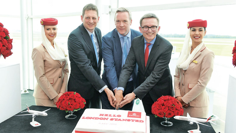 Flanked by Emirates cabin crew, Richard Jewsbury, Emirates Divisional Vice President, UK, Ken O'Toole, Stansted Airport CEO and Hubert Frach, Emirates Divisional Senior Vice President, Commercial Operations West, celebrate the new service.