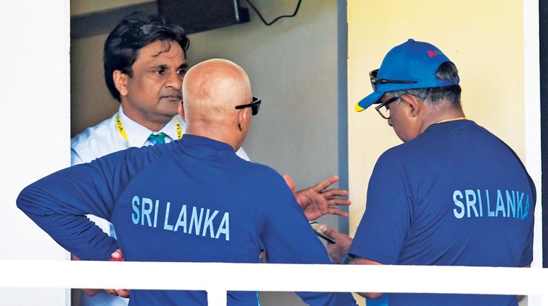Sri Lanka cricket officials Chandika Hathurusingha (left) and manager Asanka Gurusinha in animated conversation with ICC Match Referee Javagal Srinath after Sri Lanka team was accused of changing the condition of the ball during the ongoing second test against West Indies at St Lucia