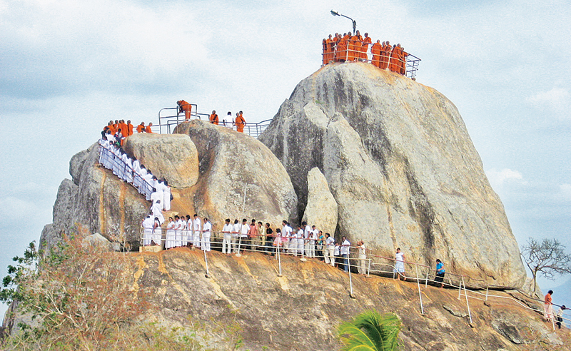 Buddhist monks and devotees on the Aradhana Gala in Mihintale. Picture by Nimal Wijesinghe, Anuradhapura Additional District Group Corr.