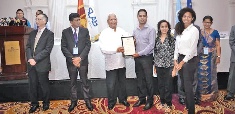 Minister Amunugama presenting accreditation certificates for conformity assessment bodies. Picture by Gayan Pushpika