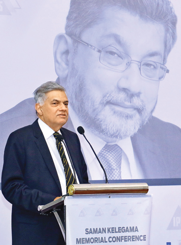 Prime Minister Ranil Wickremesinghe delivering the keynote address at the Saman Kelegama Memorial Conference at the Taj Samudra yesterday. Picture by Hirantha Gunathillaka