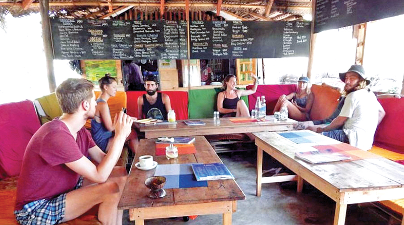 Foreign tourists in Arugam Bay.