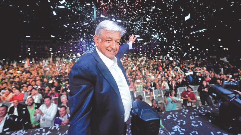 Mexico's President-elect Andres Manuel Lopez Obrador cheers his supporters. - AFP
