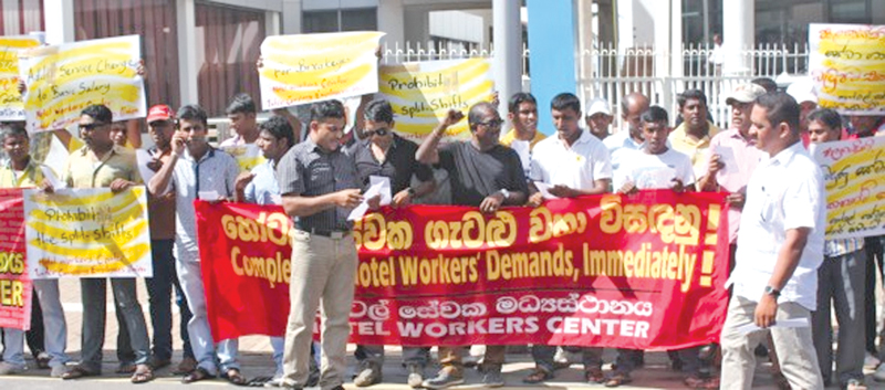 Hotel workers protest for higher wages and better working conditions. (File photo)