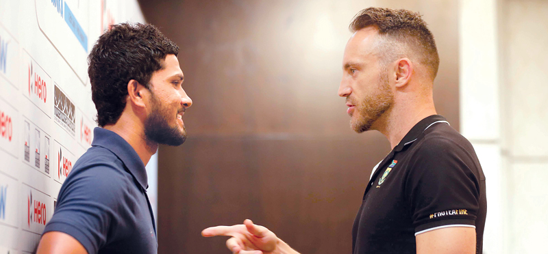Rival captains South Africa's Faf de Plessis and Sri Lanka's Dinesh Chandimal have a chat at the end of the press conference at Movenpick Hotel yesterday.