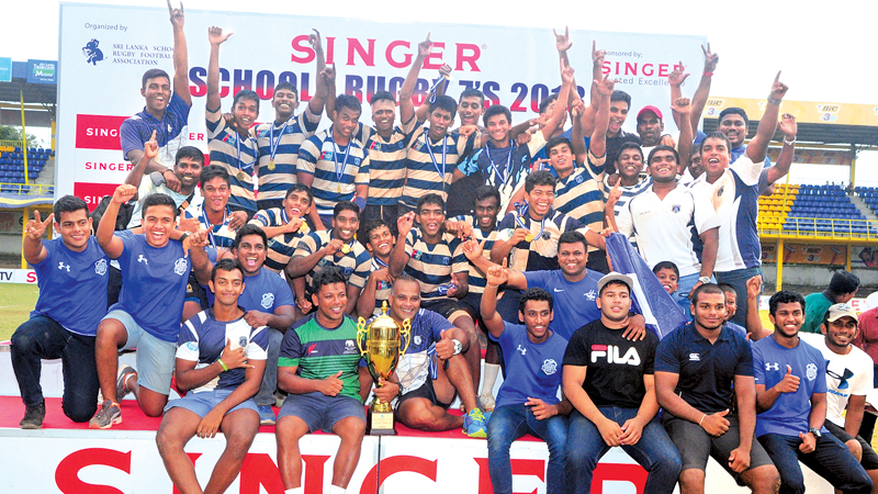 Singer inter schools rugby sevens champions St Joseph's College with the Singer trophy. Picture by Wasitha Patabendige