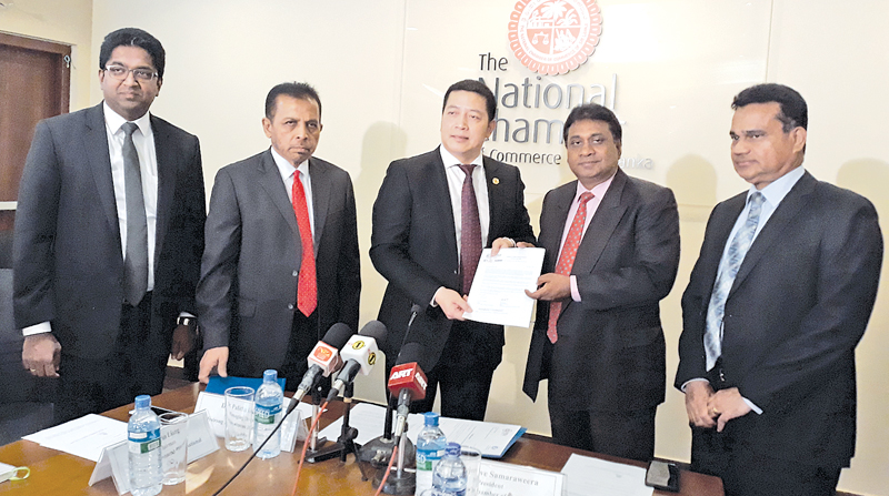 Hairong Investments International Pvt Ltd, Sri Lanka, Chairman, Pan Liag and Managing Director Dr Palitha Kohona, presenting the BRICA membership letter to President of NCCSL Sujeeva Samaraweera and Secretary Deepal Nelson.