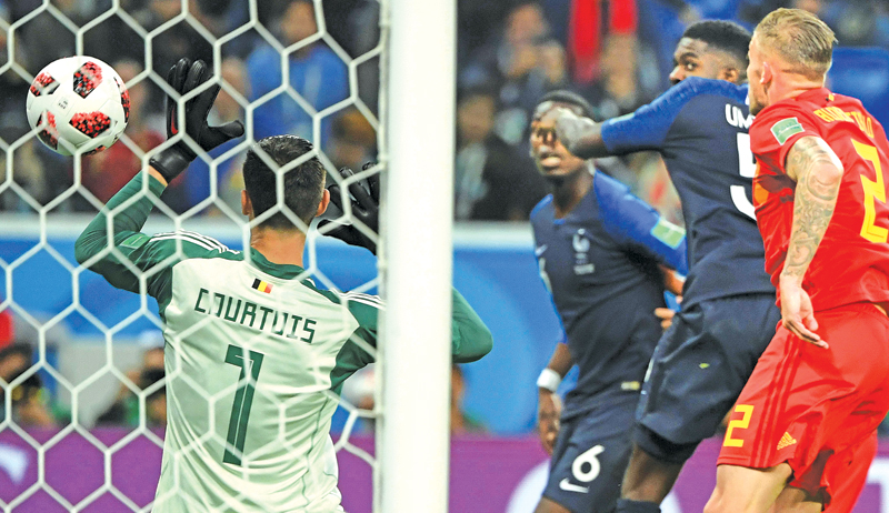 France's defender Samuel Umtiti (2R) scores the only goal during the Russia 2018 World Cup semi-final football match between France and Belgium at the Saint Petersburg Stadium in Saint Petersburg on July 10. AFP