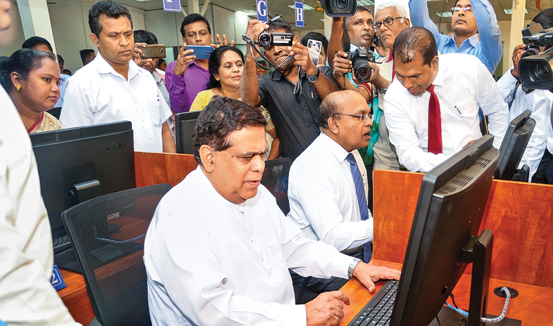 Minister Nimal Siripala de Silva inaugurating the new automated touch screen version of the driver licence exam yesterday.