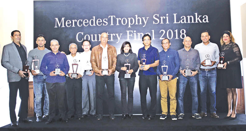 Mercedes Trophy golf 2018 winners with their trophies
