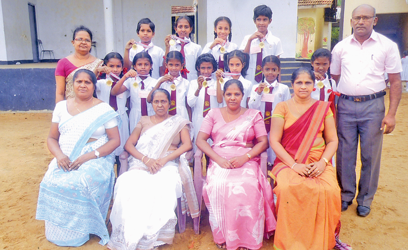 The victorious students with the College's Sports Teacher Kapila Kumara Silva and their class-teachers. Principal Mrs. Vineetha Amarathunga and the Vice Principal Mrs Pushpa Kanthi are seated in the middle.    Pic. by Kalutara Central Special Corr. H L Sunil Shantha