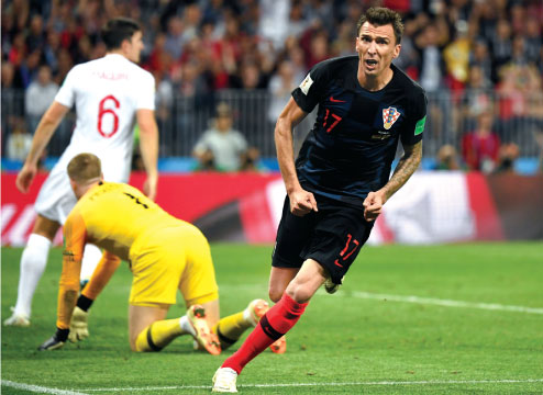 Croatia's forward Mario Mandzukic celebrates after scoring his team's second goal during the Russia 2018 World Cup semi-final football match between Croatia and England at the Luzhniki Stadium in Moscow on July 11. AFP
