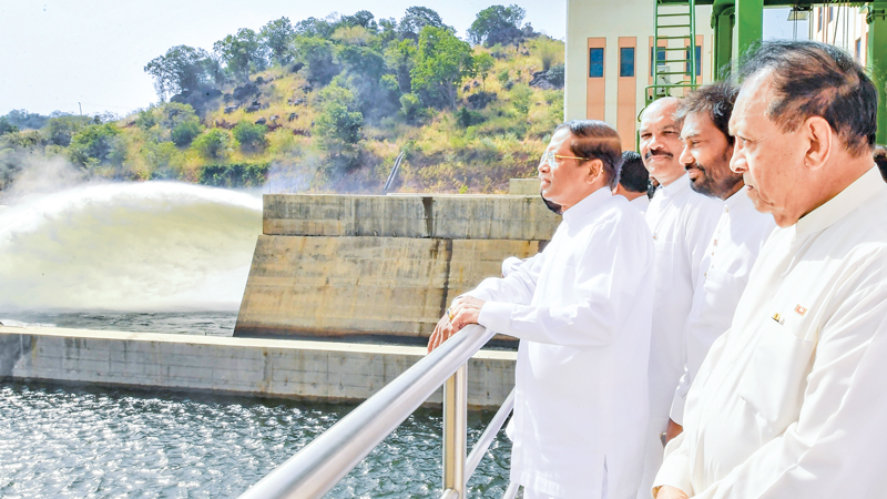 President Maithripala Sirisena taking his fill of the breathtaking Kalu Ganga - Moragahakanda reservoir shortly after commissioning the project yesterday. The Kalu Ganga-Moragahakanda project is the biggest multi-functional irrigation project aimed at irrigating parched dry lands in the Rajarata, Wayamba, Central and Eastern Provinces and Vanni in the Northern Province. Speaker Karu Jayasuriya, former President Chandrika Bandaranaike Kumaratunga, Ministers and officials were present on the occasion. Picture