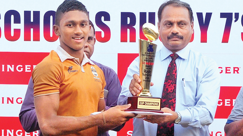 St. Peter's captain receives the champion trophy.  Pictures by Wasitha Patabendige