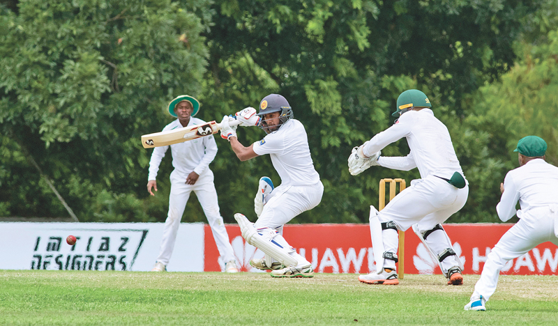 SL Emerging Team batsman Kamindu Mendis strokes the ball on the off side during their successful run chase against SA Emerging Team on the fourth and final day of the first 4-day unofficial test played at Katunayake yesterday.