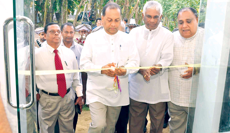 Agriculture Minister Mahinda Amaraweera opening the relocated Agro Produce Sales Point at the Labuduwa Farm premises. South ern Province Chief Minister Shan Wijayalal de Silva, Southern Province Governor Marshal Perera, Southern Agriculture Minister U. G.