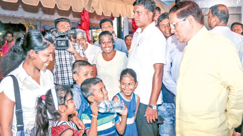 The Polonnaruwa New Market Complex built at a cost of Rs. 6.4 million under the Pibidemu Polonnaruwa programme was opened by President Maithripala Sirisena on August 4. This was one among the 180 new projects launched on a concept of President Sirisena under the Pibidemu Polonnaruwa Programme. Here, the President speaking to some children on the occasion. Polonnaruwa's Mayor Chanaka Ranasinge, Tamankaduwa Pradeshya Sabha Chairman Premasiri Munasinghe and Polonnaruwa Traders' Association President Anura Basn