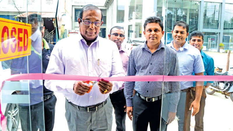Philip J.Wewita , Chairman of Pussalla Meat Producers opens the new meat shop, accompanied by Operation Manager Meat shop Chain.