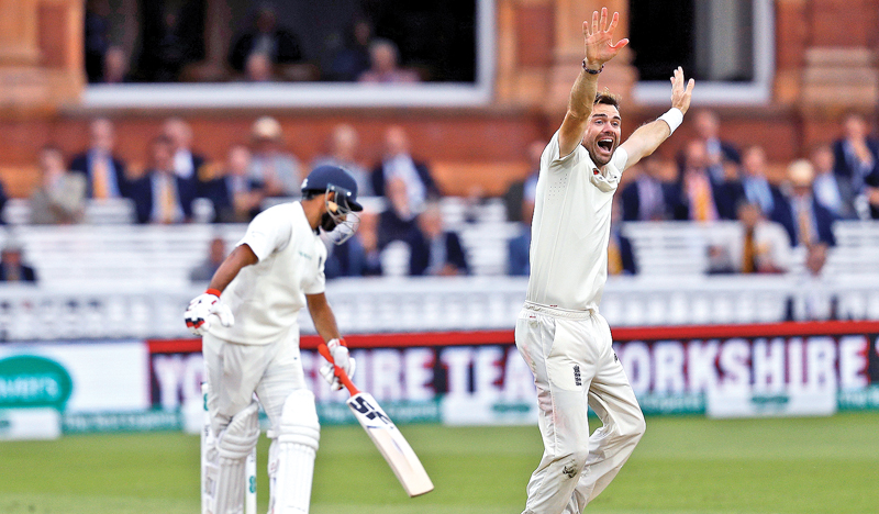 England's James Anderson (R) celebratres taking the wicket of India's Mohammed Shami for zero runs on the fourth day of the second Test cricket match between England and India at Lord's Cricket Ground in London on August 12. AFP