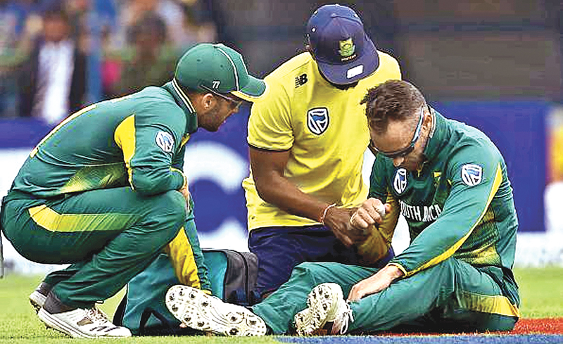 Faf du Plessis gets attention on his right shoulder.