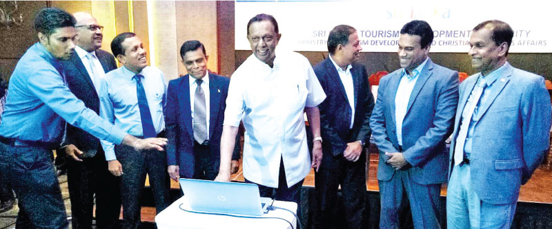 Minister of Tourism John Amaratunge, Chairman, SLTDA, Kavan Ratnayaka, business personality Kishu Gomaz, Project Coordinator, Trevine Gomez, Director General SLTDA, Upali Ratnayake and other officials launching the Tourism awards website. Picture by Sudath Malaweera