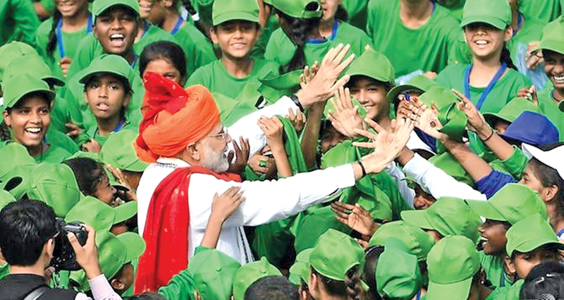 Indian Prime Minister Narendra Modi greeting schoolchildren after addressing the nation from the ramparts of New Delhi's 17th century Red Fort to mark India's Independence Day yesterday. - AFP