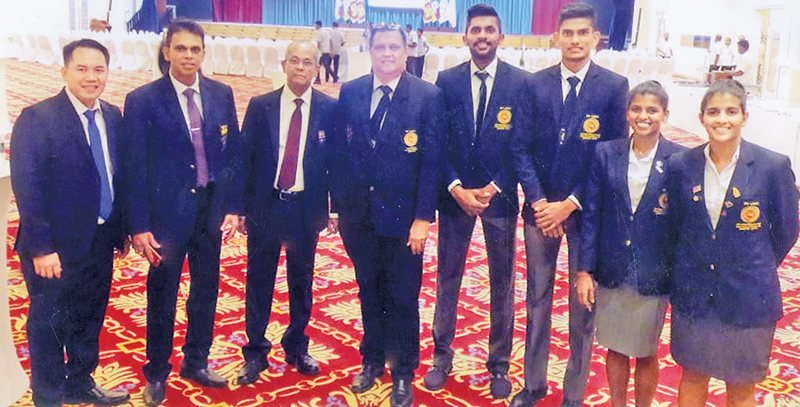 The National Badminton Team that is due to leave for Indonesian Capital Jakarta, on 20 Aug 2018 with the officials From L to R Tony Wahyudi (Coach), Nishantha Jayasinghe (President), Maxwell  de Silva (N O C Secretary) Prince Cooke (Manager), Sachin Dias (player), Bownaka Gunathilake (player), Kavindi Ishandika (player), Thilini Hendahewa (player).   (Pix by Kalutara Central Special Corr. - H L Sunil Shantha)