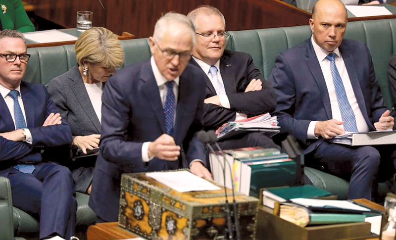 Australian Prime Minister Malcolm Turnbull speaks in Parliamnent with his challenger for the party leadership Home Affairs Minister Peter Dutton on right.