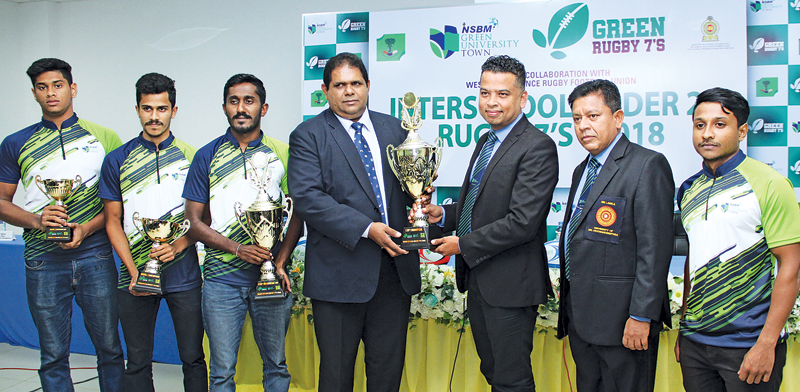 Sri Lanka Rugby president Lasitha Gunaratne and NSBM vice chancellor Chaminda Ratnayake with the challenge trophy that will be awarded to the winners of the tournament. (Picture by Ruwan de Silva)