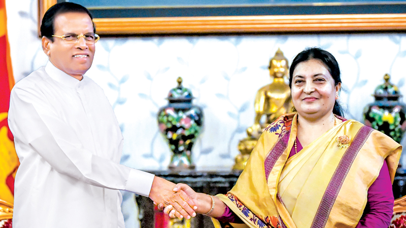 President Maithripala Sirisena who visited Nepal to attend the BIMSTEC Summit was warmly received by Nepal's President Bidhya Devi Bhandari when he called on her at her official residence Sheetal Niwas for talks on Saturday. Picture by Sudath Silva