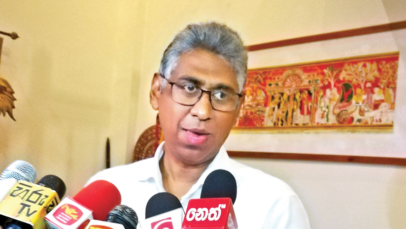 Sports Minister Faizer Mustapha speaks to media in Indonesia
