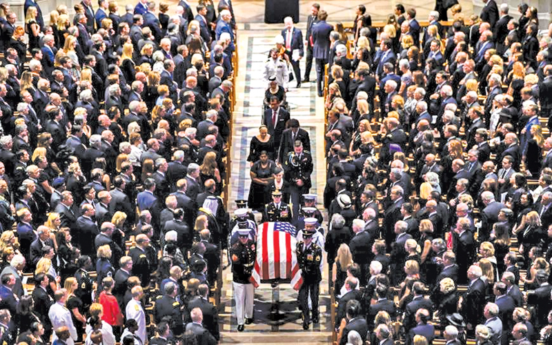 The casket of the U.S. Republican Sen. John McCain is carried out after a memorial service at the Washington National Cathedral in the U.S. capital on Saturday. - AFP