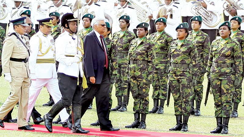 Prime Minister Ranil Wickremesinghe accompanied by Inspector General Pujith Jayasundara inspecting the Guard of Honour accorded to the Prime Minister at the 152th Police Day celebrations held at Police Park yesterday. Picture by Hirantha Gunathilake