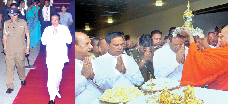President Maithripala Sirisena received blessings from the Maha Sangha after being welcomed at the Bandaranaike International Airport on his return from Nepal, on Sunday. Pictures by Chaminda Niroshana